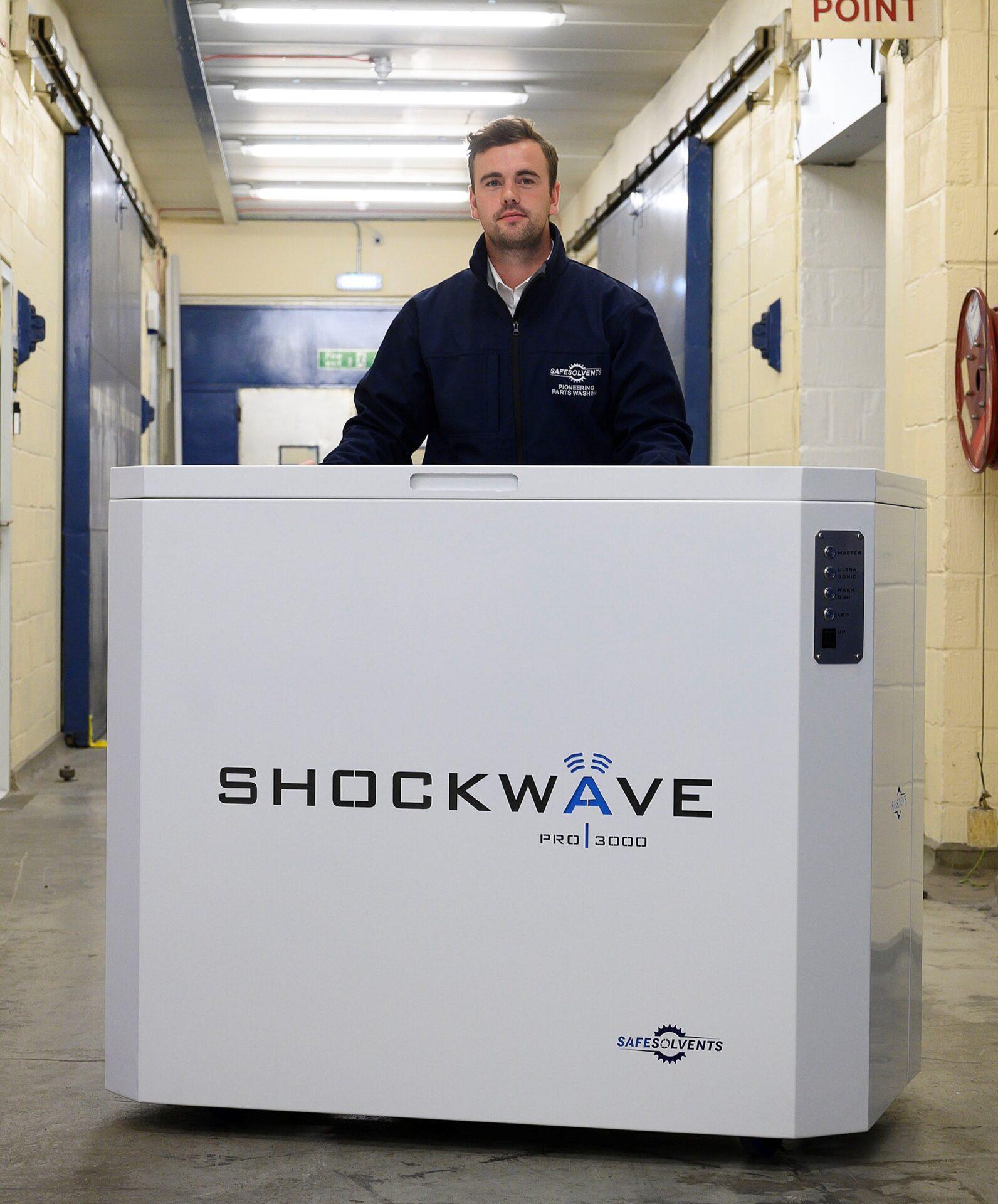 Design Engineer Kyle Dooley with a Safe Solvents Shockwave Pro 3000,